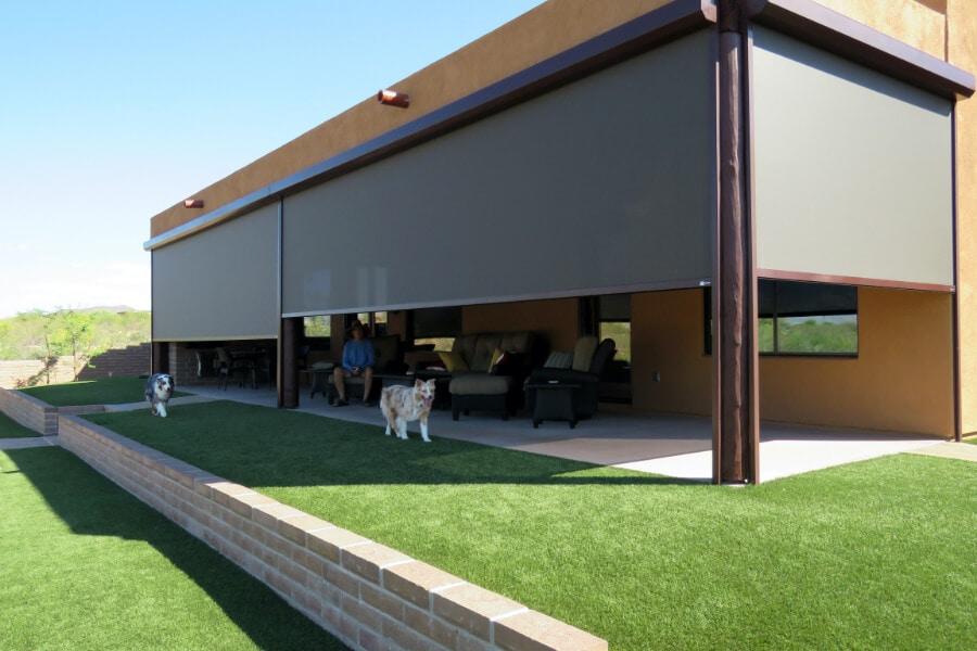 Retractable solar screens shading the patio of a Tucson, Arizona home