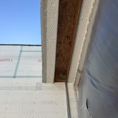Rolling shutters being installed during new construction